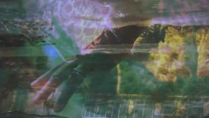 "Rebecca Barnard, frame from ""Black Coral"" music video"